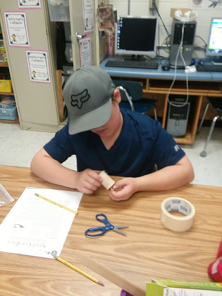 Troy building his spool car racer.